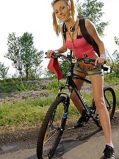 Busty chick riding bike
