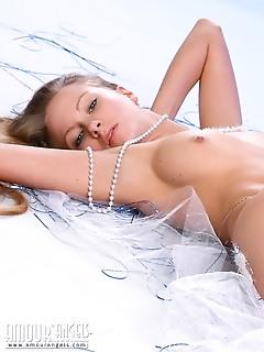 Blonde angel shows off