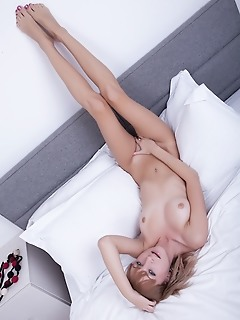 Teen angel on white bed