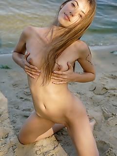 Naked at the sea shore
