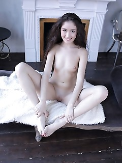 Posing naked on the sofa