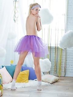 Cute babe in purple skirt